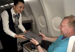 THY'den İngiltere uçuşlarında 'laptop' dağıtımı başladı